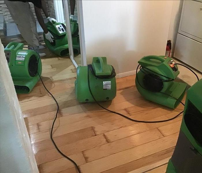 Air movers on floor.