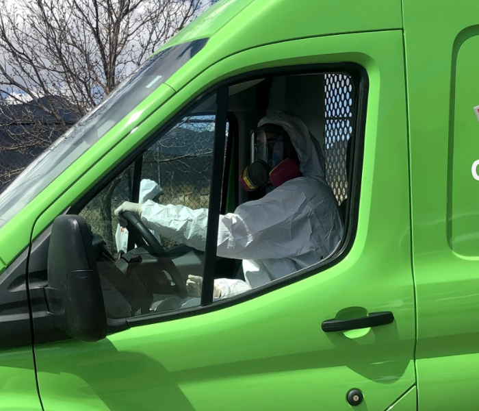 a guy in a white suit in a green van