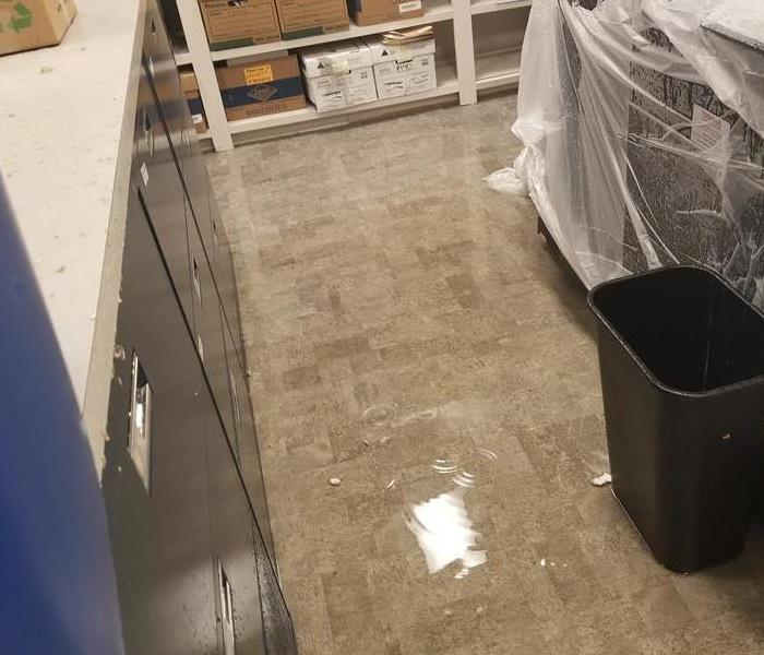 water on the ground of a commercial building