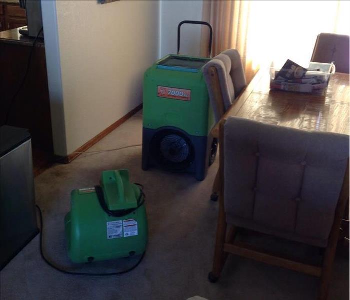 Drying equipment in formal dining room.