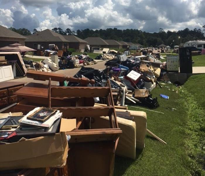 Street Stacked Possessions from Baton Rouge Flooding