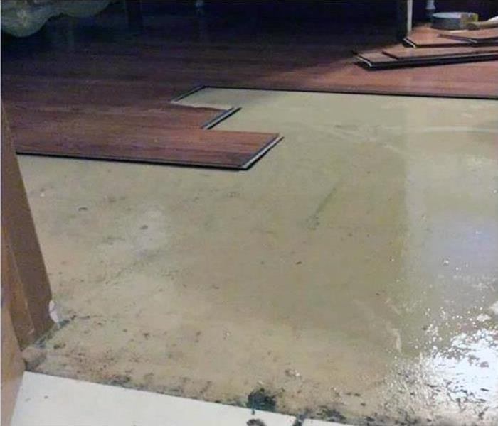 Flooring that has suffered flood damage