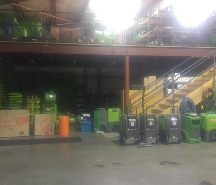 A warehouse with a large amount of SERVPRO equipment.